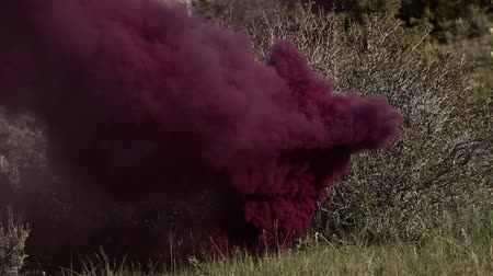 powerful : Training explosives on a hillside. They whistle and explode with a flash and a cloud of smoke. From a training for Green Beret United States Army Special Forces.