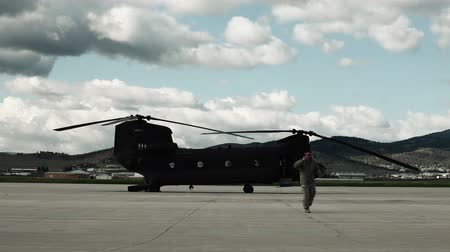 broca : Sped-up footage of soldiers inspecting a CH-47 Chinook Helicopter at an airfield. From a training for Green Beret United States Army Special Forces. Stock Footage