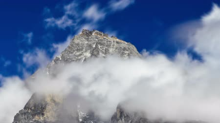 Time-lapse of clouds swirling around a Himalayan peak. Cropped.