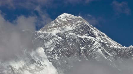 Time-lapse of clouds swirling around the summit of Mount Everest. The peak on the right is perhaps Lhotse. Cropped.