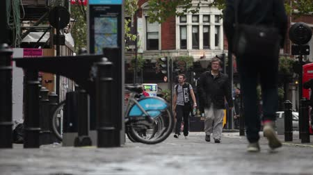 rowerek : Streets with people walking on the sidewalks in Soho Square London, England on October 9, 2011. Wideo