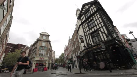 londyn : A corner street with a little diner near Soho Square in London, England. Filmed on October 9, 2011.