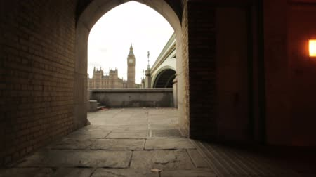 zegar : A shot of Big Ben from a tunnel underneath the bridge in London, England on October 9, 2011.