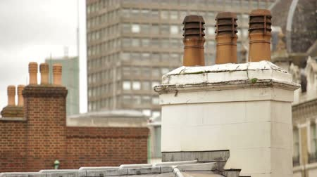 воронка : Chimney on top of building in foreground, other buildings in background, located in London, England. Filmed on October 11, 2011. Стоковые видеозаписи