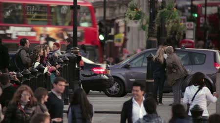 rowerek : A stationary shot of people and passing traffic near Pret A Manger on a street in London. Some people are taking photographs. Filmed on October 7, 2011.