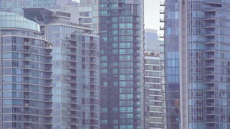 kapatmak : Panning close-up shot of Vancouver skyline from across water. Filmed in Vancouver, British Columbia, Canada. Stok Video