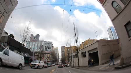 localização : Seattle, Washington - November 2011: Superwide view from car as it drives down the streets in downtown Seattle.