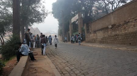 aboriginal : Mahajanga, Madagascar - CIRCA 2013 - Foggy view of teenage kids hanging out on the street as they are going to school.