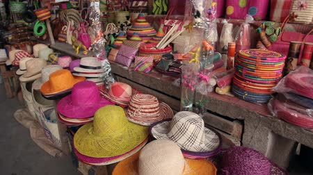 Мадагаскар : Mahajanga, Madagascar - CIRCA 2013 - Panning view of street market with colorful hats and handbags.