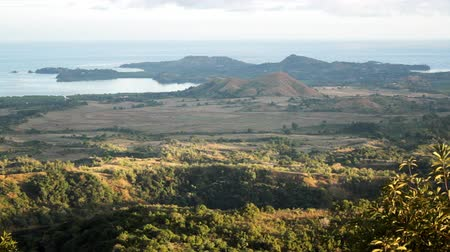 Мадагаскар : Mahajanga, Madagascar - CIRCA 2013 - View from the top of a hill overlooking the landscape toward the ocean. Стоковые видеозаписи