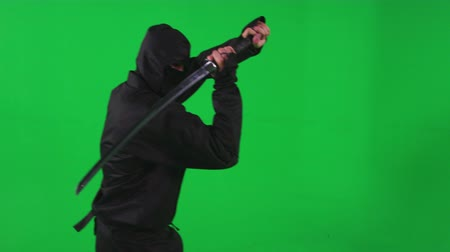 samuraj : Slow motion green screen shot of a ninja brandishing a katana