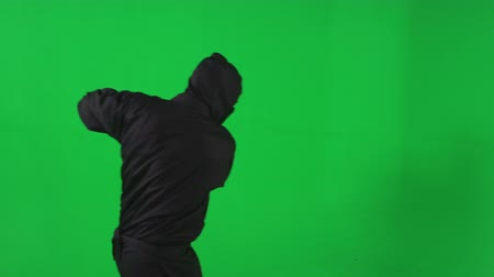 samuraj : Slow motion green screen shot of an angry ninja brandishing a katana