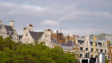 bretanha : Traveling view of the tops of buildings along River Thames in London England. Filmed on October 11 2011.