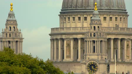 sütun : a close-up of the main dome of St. Pauls Cathedral in London England and two smaller pillars. Filmed on October 10 2011.