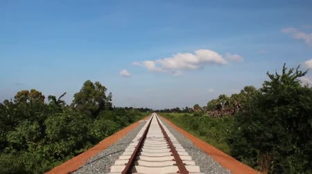 beautifully : Wide shot tile down from sky to beautifully symmetrical new railroad tracks in rural Asia