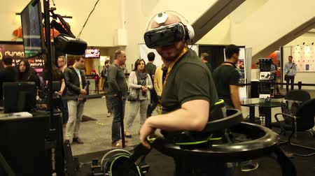 playstation : A gamer runs for his life using a specially outfitted VR running platform and VR Morpheus goggles while playing a game  One of a series of gaming industry and virtual reality technology clips From the virtual reality gaming technology