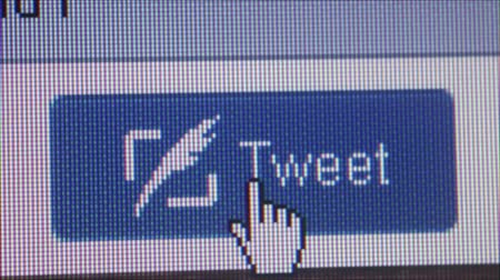 kursor : Macro close up of synchronized computer monitor showing ::  wider shot of Tweet button with user  cursor clicking on it; camera dolly right to offscreen position before returning to settle variations  ::  One of a series of social media computer icons, b