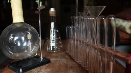 steril : Wider Dolly into Rows of Vintage test tubes, beakers and laboratory equipment