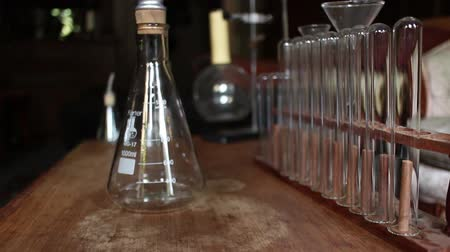 steril : Dolly into Rows of Vintage test tubes, beakers and laboratory equipment Stok Video