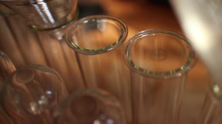 biotech : Dolly move across test tubes and beakers, suggesting science and biotechnology Stock Footage