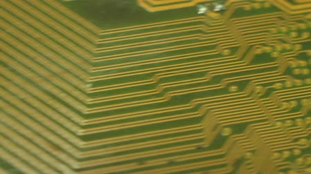 szilícium : Macro Camera Dolly across diagonal printed circuits: start from soldered circuit nipples then move to circuit cluster; return Shot with special macro lenses, this shot demonstrates a dynamic view of the developments in technology.