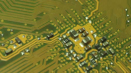 szilícium : Medium Macro Camera Dolly start at Circuit Cluster, Move to Edge of Board. Shot with special macro lenses, this shot demonstrates a dynamic view of the developments in technology.