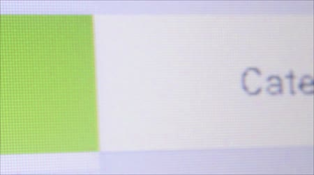 Macro close up of synchronized computer monitor showing , macro ECU of Android App store button as user moves pointer and clicks on icon. Stock Footage
