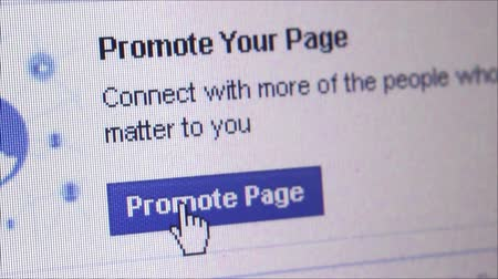 promover : Macro close up of synchronized computer monitor showing: Close up macro dolly right and settle on Facebook Promote page button. User  cursor clicks on Promote page button, with popup appearing, return to Promote page button (repeat variations).