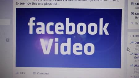 phablet : Medium close up camera dolly around Facebook main page with embedded illustrative video featuring Facebook Video.  Facebook continues to gain ground against Youtube in the video space, making this illustrative social media video clip particularly releva