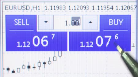 Macro view of currency sales website screen with extreme close up of user pointing at buy and sell figures with mechanical pencil. Стоковые видеозаписи
