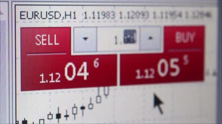 cryptocurrency : Macro medium close up of monitor showing Buy and Sell currency fluctuation values with user moving cursor to point, oblique perspective with shallow depth of field.