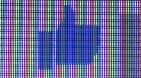 kursor : Macro close up of synchronized computer monitor showing a Blue Thumbs Up Icon appearing in in Facebook chat window and bouncing upwards. Wideo