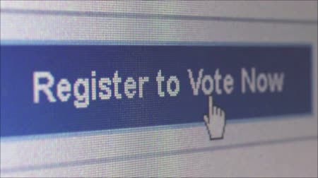 phablet : Macro close up of user moving a cursor and clicking on a banner reading Register to Vote on an online voting website; camera then dollies right and offscreen. Shot at pixel level. (*not a screengrab). One of a series of macro election and voting clips by