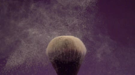 основа : Brush for tonal basis shakes powder from a fluffy brush Стоковые видеозаписи