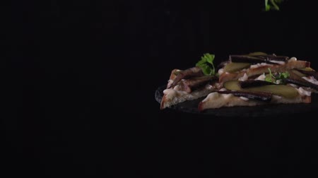 sprats : Parsley strews on sandwiches in slow motion.