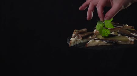 majonez : The hand puts a twig of parsley over the sandwiches.