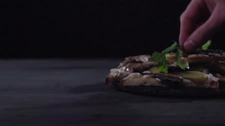 pickled : A sprig of greenery is decorated with a sandwich with sprats on top. Stock Footage