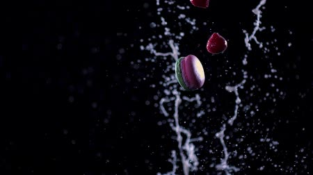 Strawberry and macaroons fly through the milk.