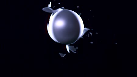 A silver Christmas ball breaks the second ball in a collision.