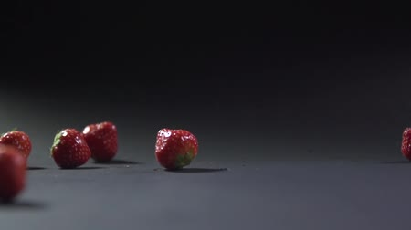 backround : Strawberry falls on top of each other and rolls over the surface.