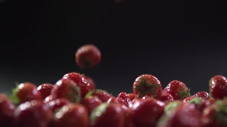 part of the frame : The berries fall on the strawberry in the frame. Stock Footage
