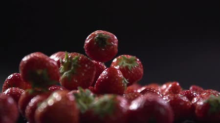 backround : Close-up of a strawberry falling on each other.