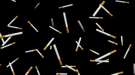 grotesque : A looping array of cigarettes against a simple black background. Stock Footage