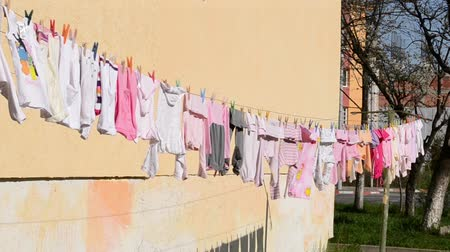 maternidade : Baby coloured little clothes are left to dry.
