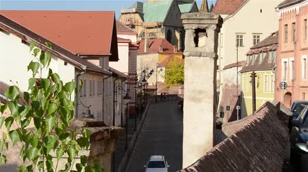 macskaköves : A chimney on the roof and a old  Middle Ages paved street, of an old town, in sunny afternoon time.