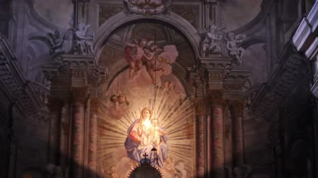 marian : Tilt shot of masterfully painted altar of an old Catholic church.