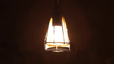decadência : Metal protected rusty lightbulb, in the basement of house, lights to the deep darkness. Vídeos