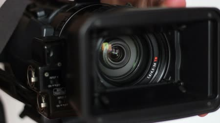 camera operator : After openning the hood the professional video camera is ready for shooting. Stock Footage