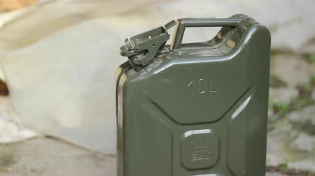 blank can : A person opens and pick up a petrol canister jerry can A jerrycan also written as jerry can or jerrican is a robust fuel container originally made from pressed steel. It was designed in Germany in the 1930s for military use to hold 20 litres 5.3 U.S. galo