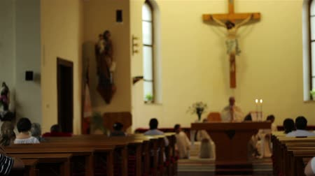 clerical : People gathered to church for the religious service kneel and pray togheter with priest. Stock Footage